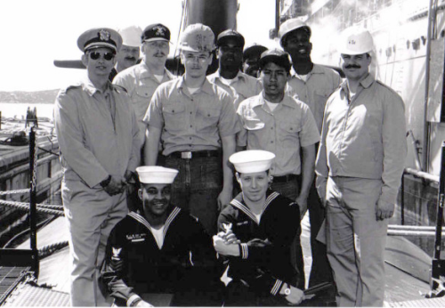 Neil Larsen with his shipmates aboard the USS Orion (AS-18)